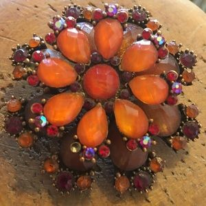 Vintage faceted orange with red stone brooch